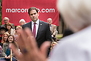 Senator and GOP presidential candidate Marco Rubio listens to a question on legalizing pot from 79-year-old Elease Pickens during the Bully Pulpit series town hall at the College of Charleston December 1, 2015 in Charleston, South Carolina.