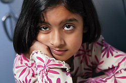 Portrait of girl leaning on her arm,