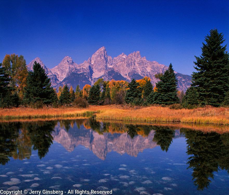 Teton range rises sharply into the Wyoming sky in Grand Teton National Park, WY.