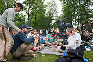 Viljandi, Estonia - July 25, 2015: Estonians play impromptu music during the annual Viljandi Folk Music Festival in Viljandi, Estonia. Behidn them is a statue of Johan Laidoner, who was exiled by Stalin when the Soviet Union occupied Estonia in 1940. He died 13 years later, in 1953, at Vladimir Central Prison outside Moscow (the same prison where American U-2 pilot Francis Gary Powers would be held less than a decade later).