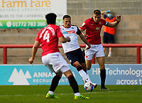 Football - 2020 / 2021 Sky Bet League Two - Morecambe vs. Bolton Wanderers<br /> <br /> Antoni Sarcevic of Bolton Wanderers goes past Sam Lavelle of Morecambe as Nat Knight-Percival covers, at the Mazuma Stadium.<br /> <br /> COLORSPORT/ALAN MARTIN
