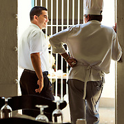 A chef and a server talking during a break at their restaurant in Trinidad, Cuba.