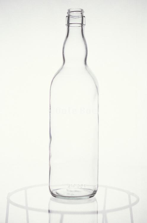 still life of glass bottle on glass table