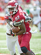 Apr 20, 2013; Fayetteville, AR, USA; Arkansas Razorback red wide receiver Mekale McKay (82) attempts to get past Arkansas Razorback white cornerback Will Hines (9) during the red vs. white spring football game at Donald W. Reynolds Razorback Stadium. Mandatory Credit: Beth Hall-USA TODAY Sports