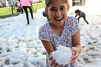 Complete with snow, children from East Salinas enjoy a full-fledged Christmas party on Wednesday afternoon,  courtesy of the second annual Cesar Chavez Library Snow Day.