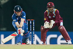 © Licensed to London News Pictures. 27/09/2012. English batsmen Eoin Morgan plays a reverse sweep shot during the T20 Cricket World super 8's match between England Vs West Indies at the Pallekele International Stadium Cricket Stadium, Pallekele. Photo credit : Asanka Brendon Ratnayake/LNP