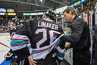 KELOWNA, CANADA - SEPTEMBER 25: Kelowna Rockets' Athletic Therapist, Scott Hoyer, tends to Cole Linaker #26 on the bench opposite the Kamloops Blazers on September 25, 2015 at Prospera Place in Kelowna, British Columbia, Canada.  (Photo by Marissa Baecker/Shoot the Breeze)  *** Local Caption *** Scott Hoyer;