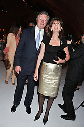 The EARL & COUNTESS OF BALFOUR at a dinner hosted by Cartier following the following the opening of the Chelsea Flower Show 2012 held at Battersea Power Station, London on 21st May 2012.