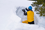 Backcountry skier building a kitchen shelter, Yosemite National Park, California