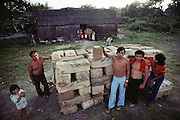 A chicle camp in Xpujil, Campeche Mexico. Chicle is a tree, and the main ingredient in traditional chewing gum. The sap is collected by chicleros working in the jungle. Here blocks of chicle are stacked by a dirt airstrip ready to be shipped out.