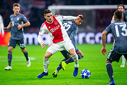 12-12-2018 NED: Champions League AFC Ajax - FC Bayern Munchen, Amsterdam<br /> Match day 6 Group E - Ajax - Bayern Munchen 3-3 / Dusan Tadic #10 of Ajax, Serge Gnabry #22 of Bayern Munich