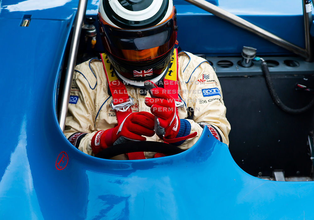 Image of a race car driver prepping at the Pacific Northwest Historics, Pacific Raceways, Auburn, Washington, Pacific Northwest by Randy Wells