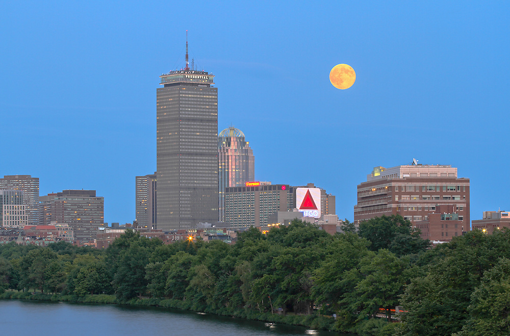 Boston skyline photography showing a full moon across the cityscape of historic landmarks such as the Prudential Center, Citgo Sign and Boston University on a beautiful summer night.<br /> <br /> <br /> This Boston photo image is available as museum quality photography prints, canvas prints, acrylic prints or metal prints. Prints may be framed and matted to the individual liking and decorating needs: <br /> <br />  http://juergen-roth.pixels.com<br /> <br /> Good light and happy photo making!<br /> <br /> My best,<br /> <br /> Juergen<br /> Prints: http://www.rothgalleries.com<br /> Photo Blog: http://whereintheworldisjuergen.blogspot.com<br /> Twitter: @NatureFineArt<br /> Facebook: https://www.facebook.com/naturefineart