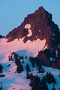 Pinnacle Peak, located in the Tatoosh Range in Mt. Rainier National Park, is bathed in the warm light of a late spring sunrise. At 6562 feet, it's the second-highest peak in the Tatoosh Range.