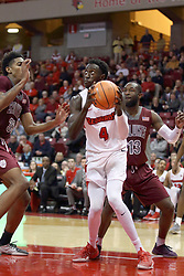 "08 February 2018:  While doubled and cornered by Kavion Pippen and Sean Lloyd Jr., Daouda ""David"" Ndiaye looks for the hoop during a College mens basketball game between the Southern Illinois Salukis and Illinois State Redbirds in Redbird Arena, Normal IL"