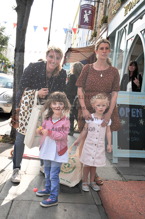 Left to right, LAURA LOPES daughter of the Duchess of Cornwall, her daughter ELIZA and SARA PARKER-BOWLES and her daughter LOLA at the opening of the new HoneyJam children's store at 2 Blenheim Crescent, London W11 on 7th July 2011.