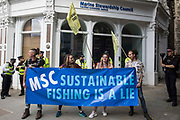 Activists from Ocean Rebellion stand outside the offices of the Marine Stewardship Council during a National Animal Rights March on 28th August 2021 in London, United Kingdom. Animal Rebellion, an offshoot of Extinction Rebellion, organised the march for the sixth day of Extinction Rebellions protests in London, with stops at Smithfield meat market, Unilever which owns brands that sell dairy products and use palm oil, Cargill which is one of the worlds largest meat processors and the Marine Stewardship Council.