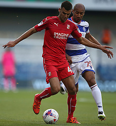 Swindon Town's Conor Thomas and Queens Park Rangers's Karl Henry battle for the ball