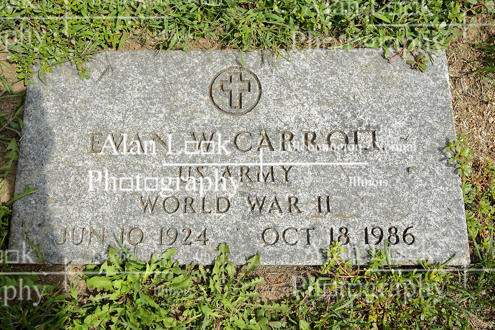 31 August 2017:   Veterans graves in Park Hill Cemetery in eastern McLean County.<br /> <br /> Evan W Carroll  US Army  World War II  Jun 10 1924  Oct 18 1986