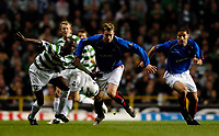 Photo: Jed Wee.<br /> Celtic v Glasgow Rangers. Scottish CIS Insurance Cup. <br /> 09/11/2005.<br /> <br /> Rangers' Alan Hutton (C) tries to get away from Celtic's Mo Camara.