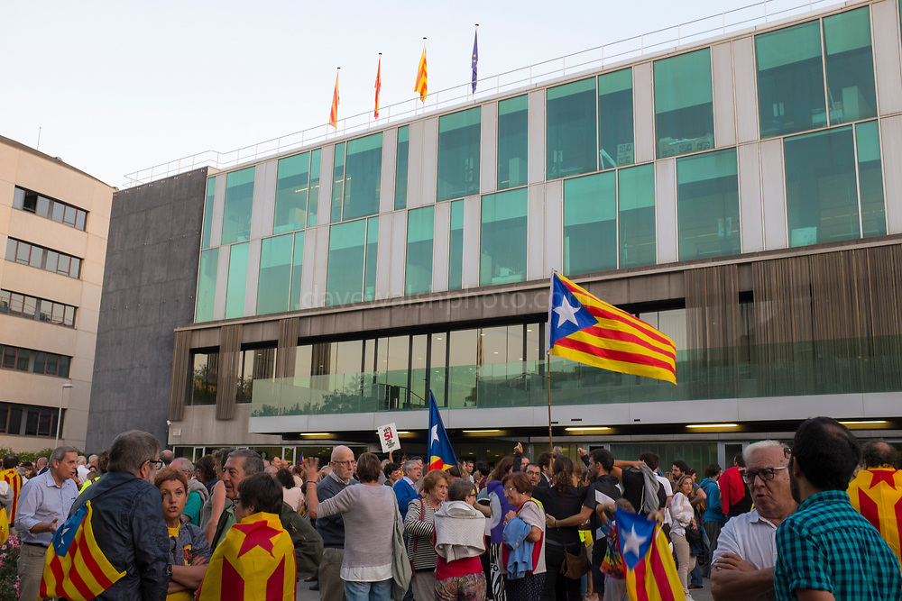 A large group of residents gathers outside the City Hall of Sant Cugat, Barcelona, Catalonia on September 20th to protest raids by the Spanish government authorities on companies, government offices and political parties, the arrest of politicians and activists and the confiscation of  referendum materials by the Catalan independence movement. Ordinary people have started printing and distribution of posters and have taken to the streets in response. Spanish authorities have threatened more than 700 Catalan mayors including the mayor of Sant Cugat, with prosecution if they go ahead with the referendum.