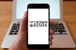 Using iPhone smartphone to display logo of The Crown Estate, UK Government property management department