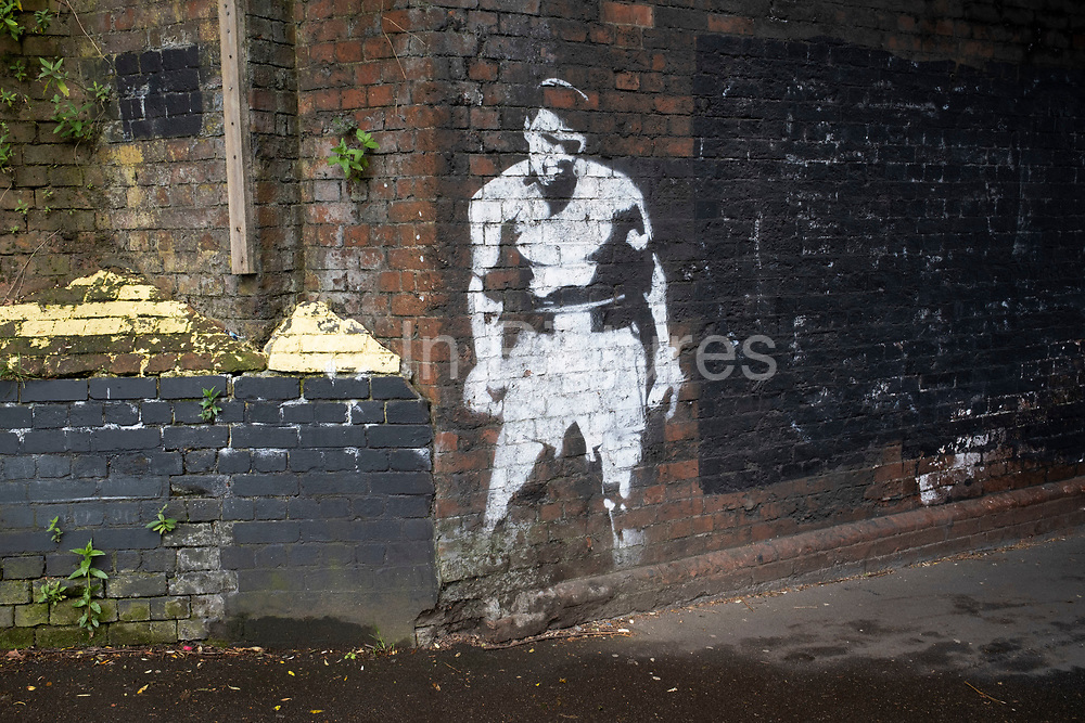 Railway arch with Muhammad Ali street art graffiti of his famous defeat of Sonny Liston in Sparkbrook, the inner city area of Birmingham which is virtually deserted under Coronavirus lockdown on 29th April 2020 in Birmingham, England, United Kingdom. Coronavirus or Covid-19 is a new respiratory illness that has not previously been seen in humans. While much or Europe has been placed into lockdown, the UK government has put in place more stringent rules as part of their long term strategy, and in particular social distancing.