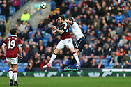 Ashley Barnes of Burnley jumps for the ball with Jan Vertonghen of Tottenham Hotspur. Premier League match, Burnley v Tottenham Hotspur at Turf Moor in Burnley , Lancs on Saturday 1st April 2017.<br /> pic by Chris Stading, Andrew Orchard sports photography.