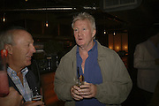 Tony Chapel and Rodney Marsh, Drinks at OQO, Islington Green  after  screening of ' Once In a Lifetime-Thje extraordinary Story of the New York Cosmos at the Screen On the Green, Islington. London. 15 May 2006. ONE TIME USE ONLY - DO NOT ARCHIVE  © Copyright Photograph by Dafydd Jones 66 Stockwell Park Rd. London SW9 0DA Tel 020 7733 0108 www.dafjones.com