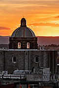 Sunset over the iconic San Francisco church dome in the historic center of San Miguel de Allende, Guanajuato, Mexico.