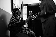A young pregnant woman visits the local dai for a medical check up. Young midwives today are becoming more educated and working in a more professional manner, using the right equipment and under better hygienic conditions. Kandiaro, Pakistan, 2010