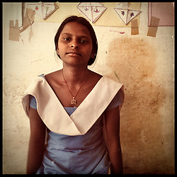 """iPhone portrait of Basanti Kumari Maayida, 11, in a village outside of Banswara, Rajasthan, India, April 5, 2013. """"She was young, my sister was between 10 and 12 years old when she was married. I watched as she got pregnant and then very weak. Then my parents were forcing me to marry someone, but I said no to my marriage. I want to become a teacher, that is why I refused,"""" said Maayida. <br /> <br /> Under Indian law, children younger than 18 cannot marry. Yet in a number of India's states, at least half of all girls are married before they turn 18, according to statistics gathered in 2012 by the United Nations Population Fund (UNFPA). However, young girls in the Indian state of Rajasthan—and even a few boys—are getting some help in combatting child marriage. In villages throughout Tonk, Jaipur and Banswara districts, the Center for Unfolding Learning Potential, or CULP, uses its Pehchan Project to reach out to girls, generally between the ages of 9 and 14, who either left school early or never went at all. The education and confidence-building CULP offers have empowered young people to refuse forced marriages in favor of continuing their studies, and the nongovernmental organization has provided them with resources and advocates in their fight."""