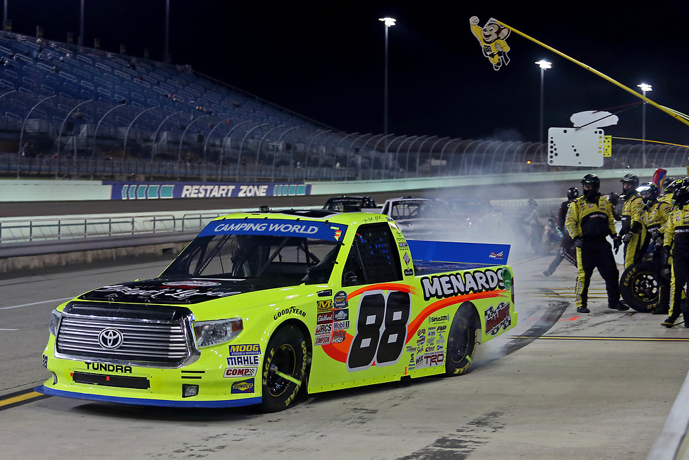 Nov 18, 2016; Homestead, FL, USA; NASCAR Camping World Truck Series driver Matt Crafton (88) makes a pit stop during the Ford Ecoboost 200 at Homestead-Miami Speedway. Mandatory Credit: Peter Casey-USA TODAY Sports