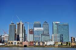 © Licensed to London News Pictures. 26/06/2017. <br /> NORTH GREENWICH, UK.<br /> Heatwave weather and clear blue sky above Canary Wharf, London.<br /> Photo credit: Grant Falvey/LNP