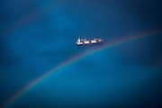 A rainbow over a cargo ship sailing across the Indian Ocean travelling between Dar-Es-Salaam and Zanzibar taken from an aeroplane.  (photo by Andrew Aitchison / In pictures via Getty Images)