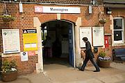 Man walks into Manningtree station entrance, Essex, England
