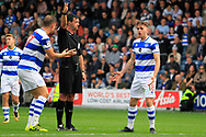 Queens Park Rangers defender Jack Robinson (18) reacts to a decision from referee Andrew Madley during the EFL Sky Bet Championship match between Queens Park Rangers and Burton Albion at the Loftus Road Stadium, London, England on 23 September 2017. Photo by Richard Holmes.