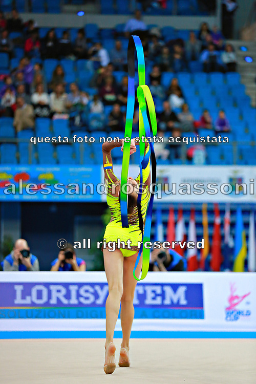 Romanova Eleonora during qualifying at ribbonin Pesaro World Cup at Adriatic Arena on April 11, 2015. Eleonora was born August 17,1998 in Krasnodonl, Ukrain. After september 2016 obtained Russian citizenship, and become a Russian individual rhythmic gymnast.