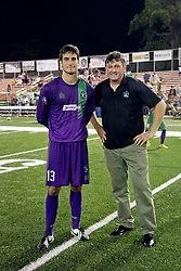 06 June 2015. New Orleans, Louisiana.<br /> National Premier Soccer League. NPSL. <br /> Head coach Kenny Farrell with goalkeeper Andrew Tarbell who makes his final appearance for the New Orleans Jesters as they take on Chattanooga FC in a Conference game at home in the Pan American Stadium. Chattanooga take a 4-0 victory over the Jesters.<br /> Photo; Charlie Varley/varleypix.com