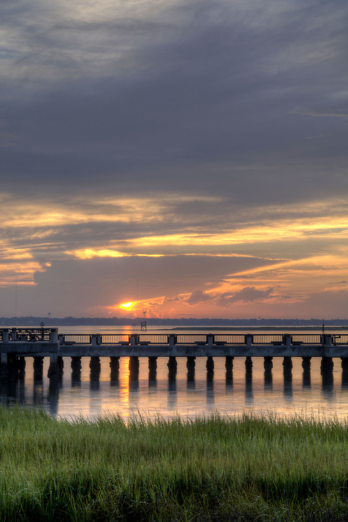 A cloudy sunrise looking across the visitor pier at Waterfront Park in Charleston, SC on Wednesday, September 3, 2014. Copyright 2014 Jason Barnette