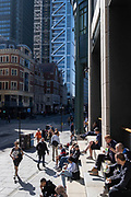 City workers relax in late-summer sunshine on the steps outside Liverpool Street Station in the City of London, the capital's financial district, on 24th September 2021, in London, England.
