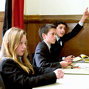 Pupils during a lesson at Ampleforth College, North Yorkshire, UK. Ampleforth College is a coeducational independent day and boarding school in the village of Ampleforth, North Yorkshire, England. It opened in 1802 as a boys' school, and is run by the Benedictine monks and lay staff of Ampleforth Abbey.