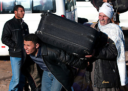 © under license to London News Pictures. 23/02/2011. A refugee carrying a suitcase crosses into Egypt from Libya at the Salloum Land Port. Photo credit should read Michael Graae/London News Pictures