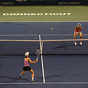 Martina Hingis, Switzerland, in action during her doubles match loss with team mate Daniela Hantuchova, Slovakia, against Cara Black and Vania King who won 6-3 6-1 during the New Haven Tennis Open at Yale, Connecticut, USA. 20th August 2013. Photo Tim Clayton
