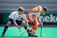 ROTTERDAM - HOCKEY -  Jelle Galema met een Engelsman  tijdens de oefenwedstrijd tussen de mannen van Nederland en Engeland (2-1) . FOTO KOEN SUYK