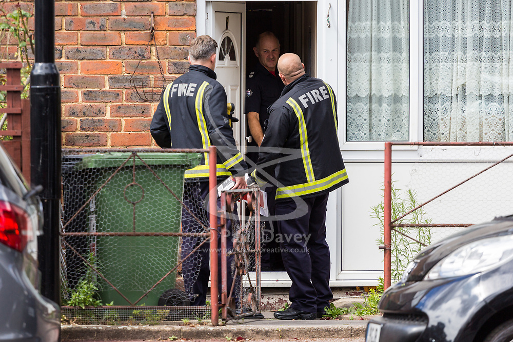 Firefighters go house-to-house offering to fit smoke alarms in the street where seven-year-old Joel Urhie died in a suspected arson attack on his home in Deptford in the early hours of Tuesday 7th August. London, August 08 2018.