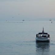 Tourist boat arriving at pier. Santa Barbara, CA.