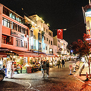 Night shot of a street of restaurants and shops in the Cankurtaran district of Istanbul (often referred to as Sultanahmet) very close to the Blue Mosque.