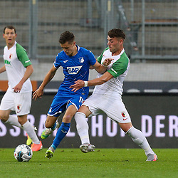 l-r: im Zweikampf, Aktion, mit Christoph Baumgartner #14 (TSG 1899 Hoffenheim) und Eduard Loewen #29 (FC Augsburg), FC Augsburg vs. TSG 1899 Hoffenheim, 17.06.2020,<br /> <br /> Foto: Christian Kolbert/kolbert-press/pool/PIX-Sportfotos<br /> <br /> - DFL regulations prohibit any use of photographs as image sequences and/or quasi-video<br /> - Editorial Use ONLY<br /> - National and International News Agencies OUT