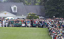 April 8, 2018 - Augusta, GA, USA - The gallery looks on while Tiger Woods tees off on the first hole to begin his final round in the Masters at Augusta National Golf Club on Sunday, April 8, 2018, in Augusta, Ga. (Credit Image: © Curtis Compton/TNS via ZUMA Wire)